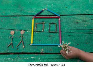 the child draw picture with colorful pens and flowers on the wooden green table in the nursery or school for activity concept. creative ideas for child development.back to school.Happy teachers day.