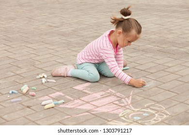 child is drawing chalk mom
