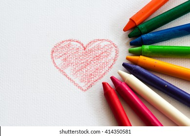 child drawing heart, drawing with pencil painting picture on paper, artwork workplace