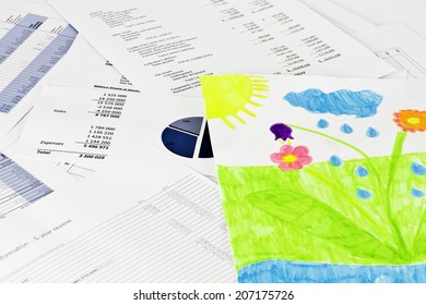 Child drawing on business financial analise reports