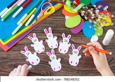 The child draws details of the Easter gift wreath. Hand-made. Children's art project for children. Craft for kids.