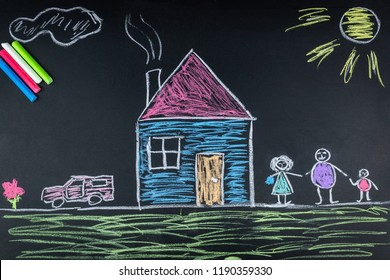 child draws a family a house and a car on the school Board