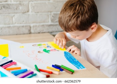 Child draws oil pastel drawing of family on the beach. Wakacje - Polish word for summer vacation. - Shutterstock ID 662362579