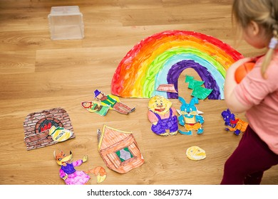 child draws a rainbow