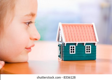 Child dreaming about a new house or home