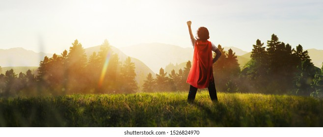 child dreaming of super hero in the mountain