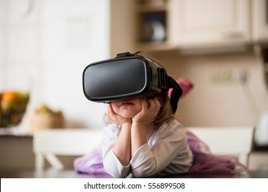 Child dreaming with virtual reality headset indoors at home
