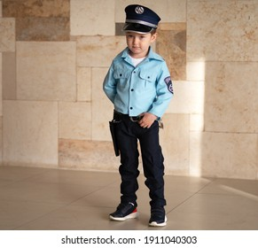 A child dressed as a police officer. The holiday of Purim Israel. Outdoor.