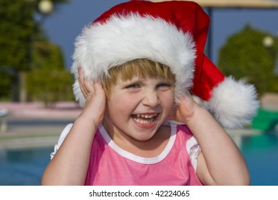 Child dressed in a Santa Claus hat