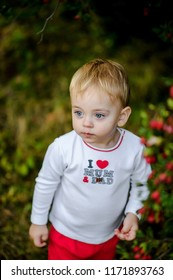 child dressed in t-shirt with inscription love mum & dady
