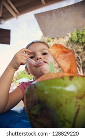 Child drink coconut milk and coconut is coconut pulp