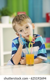 Child drink fresh orange juice.