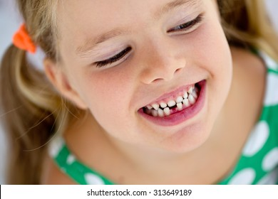 The child dropped the first milk tooth