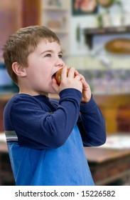 Child Eating Apple