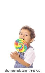 child eating a big lollipop