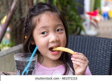 Child Eating French Fries