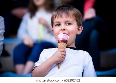 Child eating ice cream, portrait, close-up