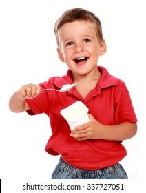 child eating a yoghurt