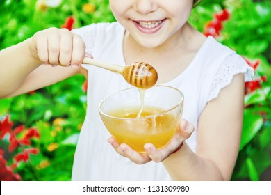 The child eats honey. Selective focus. nature food