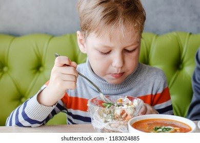 the child eats the salad at the table,Olivier, a hodgepodge