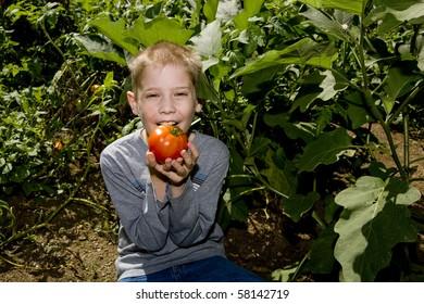 A child eats a tomato.