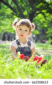 A child eats watermelon. Selective focus.