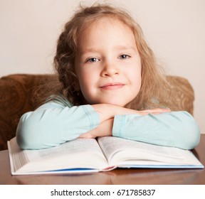 Child education. Girl reading book.