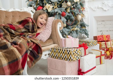 Child enjoy the holiday. Beat the Christmas rush. The morning before Xmas. Little girl. Christmas tree and presents. Happy new year. Winter. xmas online shopping. Family holiday.