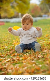Child enjoying autumn time