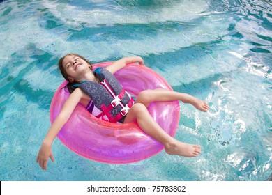Child enjoying playing in the swimming pool