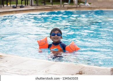 Child Enjoying Swimming in a Pool in Summer