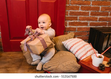 child enjoys the gifts for Christmas, birthdays