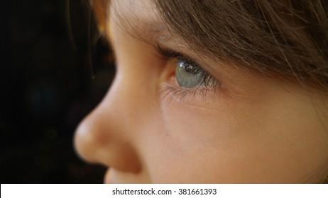 Child eye macro closeup, shallow DOF.