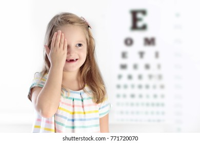 Child at eye sight test. Little kid selecting glasses at optician store. Eyesight measurement for school kids. Eye wear for children. Doctor performing eye check. Girl with spectacles at letter chart