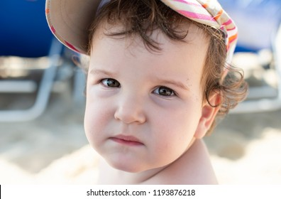 Child face on the beach. Close up
