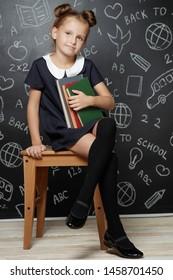 Child fashion school. Teen girl preparing for school. School uniform.