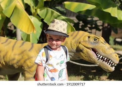child in a favorite dinosaur park