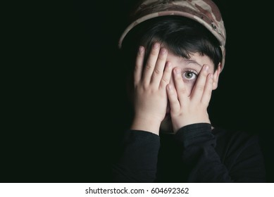 Child with fear on black background