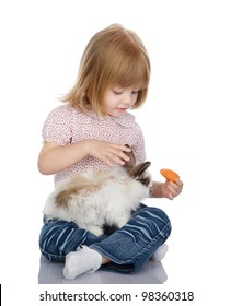 The child feeds a rabbit. isolated on white background