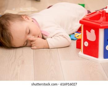 The child fell asleep on the floor