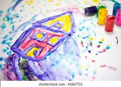 child-fingerpainting-house-vivid-colors-