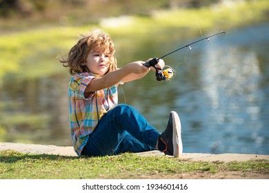 Child fishing on the lake. Kid fisher boy with spinner at river. Portrait of excited boy fishing. Boy at jetty with rod. Fishing concept