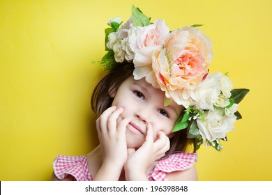 Child with flower crown on head