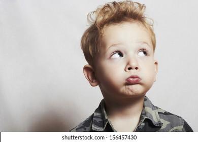 child. funny little boy. close-up. joy. 4 eyers old. military shirt