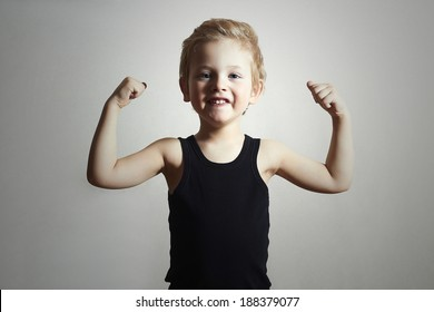 Child. Funny Little Boy.Sport Handsome Boy. Strong. bodybuilder. showing his hand biceps muscles