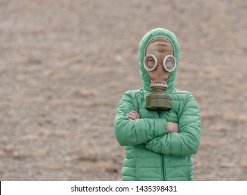 Child in a gas mask on a deserted field. Apocalypse postnuclear Doomsday scenario