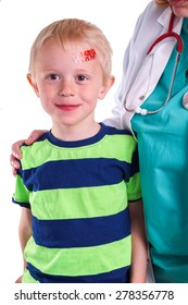 Child gets injury on the forehead and the nurse helps with getting plaster on the wound so it can heal