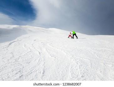 Child getting trained to ski at Bakuriani, Georgia