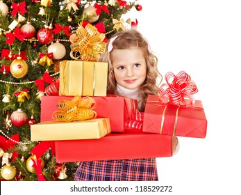 Child with gift box near Christmas tree.Isolated.