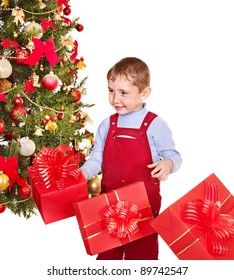 Child with gift box near Christmas tree. Isolated.